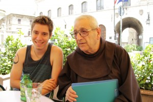Matteo sharing a drink with Padre GianMaria